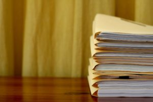 stacks of folders containing info on wills & trusts
