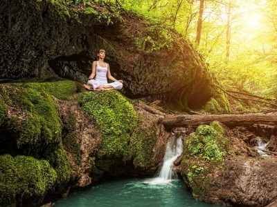 girl practicing mindfulness meditation in forest