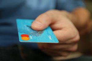 hand on a blue credit card - conservatorship