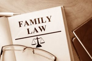 a book on Family Law on a table with glasses resting on it