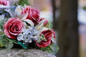 flowers laid down over a grave after parent's death