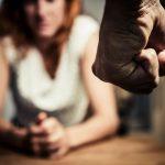 domestic violence defense women stares down fist
