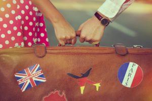 couple both clutching bag signifying international custody battles
