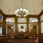 Empty courtroom with lights on