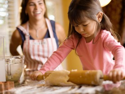 single mother cooking with her young daughter, alimony concerns